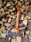 Photo of the axe amongst a logpile