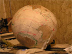 The ball covered in masking tape, with the saient poprtions of the tape removed ready for staining
