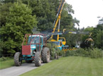 Big Blue tractor works alongside a massive crane to clear up a felled tree