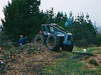 Photograph of the large blue tractor in the distance doing some heavy duty work